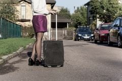 Woman with travel bag on the street, getting ready for jorney.  Stock Photos