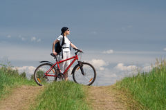 Woman travel with bike Stock Photo