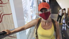 Woman travel caucasian visitor at a supermarket with wearing protective medical mask. Girl tourist customer a grocery