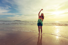 Woman travel enjoy take a photo selfie on the beach with sunrise Royalty Free Stock Photo