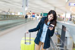 Woman travel with luggage in airport Royalty Free Stock Images