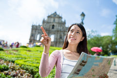 Woman travel in Macao with paper map Stock Image