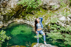 Woman travel in mountain river eco tourist Royalty Free Stock Photos