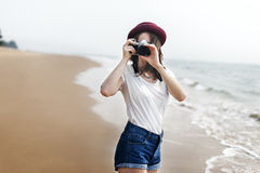 Woman Travel Photographing Beach Concept. Woman Travel Photographing Beach Scenery Stock Photo
