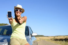 Woman on travel showing phone screen royalty free stock image