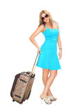 Woman with travel suitcase Stock Photography