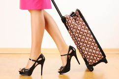 Woman with travel suitcase. Woman's legs and travel suitcase Royalty Free Stock Photos