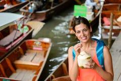 Woman on travel to thailand at Damnoen Saduak floating market Stock Photography