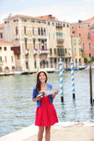 Woman travel tourist with camera and map in Venice Royalty Free Stock Image