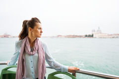 Woman travel by vaporetto in venice, italy Royalty Free Stock Photo