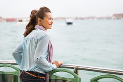 Woman travel by venice water bus Stock Images