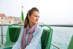 Woman travel by venice water bus Stock Photo