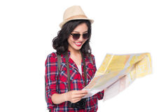 Woman travel. Young beautiful asian woman traveler watching map. Standing over white Stock Photography