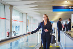 Woman on travelator in the international airport Stock Photography