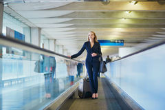 Woman on travelator in the international airport Royalty Free Stock Image