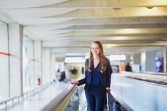 Woman on travelator in the international airport Stock Images