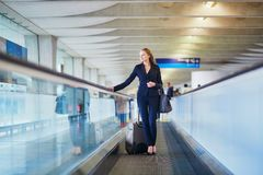 Woman on travelator in the international airport Royalty Free Stock Photography
