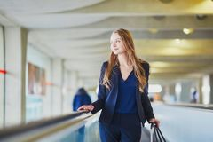 Woman on travelator in the international airport Stock Photos