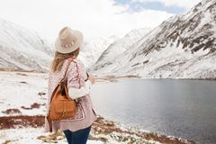 Woman traveler on the background of a mountain lake stock images