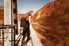 Woman traveler with a backpack Stock Photos