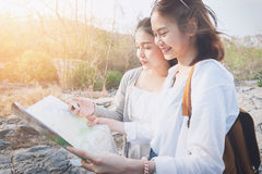 Woman traveler with backpack checks map to find Path is a goal. vintage tone. Woman traveler with backpack checks map to find Path is a goal. vintage tone Stock Photography
