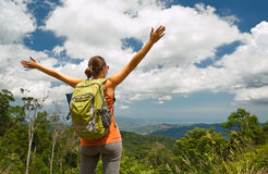 Woman traveler with backpack enjoying mountains view Stock Image