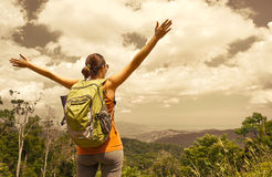 Woman traveler with backpack enjoying mountains view Royalty Free Stock Images