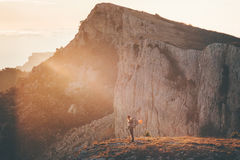 Woman Traveler with backpack hiking on cliff Royalty Free Stock Photography