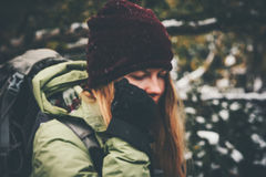 Woman Traveler with backpack hiking in forest Stock Photo