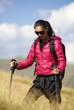 Woman Traveler with Backpack hiking in Mountains with beautiful Royalty Free Stock Photography