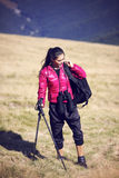 Woman Traveler with Backpack hiking in Mountains with beautiful Royalty Free Stock Photo
