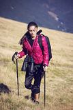 Woman Traveler with Backpack hiking in Mountains with beautiful Stock Photo