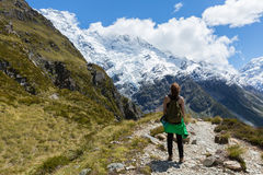 Woman Traveler with Backpack hiking in Mountains Stock Images