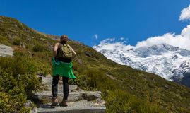 Woman Traveler with Backpack hiking in Mountains Royalty Free Stock Photos