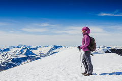 Woman Traveler with Backpack hiking in Mountains. Norway royalty free stock image