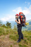 Woman traveler with backpack hiking in mountains Royalty Free Stock Images