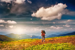 Woman Traveler with Backpack hiking in Mountains Stock Photos