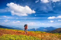 Woman Traveler with Backpack hiking in Mountains Royalty Free Stock Photography