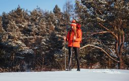 Woman Traveler with backpack hiking Travel Lifestyle adventure concept active vacations outdoor. Beautiful landscape Stock Image