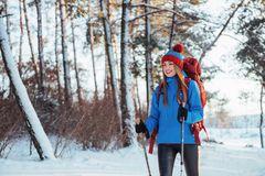 Woman Traveler with backpack hiking Travel Lifestyle adventure concept active vacations outdoor. Beautiful landscape Stock Images