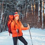 Woman Traveler with backpack hiking Travel Lifestyle adventure concept active vacations outdoor. Beautiful landscape Royalty Free Stock Photo