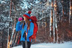 Woman Traveler with backpack hiking Travel Lifestyle adventure concept active vacations outdoor. Beautiful landscape Royalty Free Stock Image