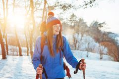 Woman Traveler with backpack hiking Travel Lifestyle adventure concept active vacations outdoor. Beautiful landscape Stock Photo