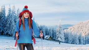 Woman Traveler with backpack hiking Travel Lifestyle adventure concept active vacations outdoor. Royalty Free Stock Images