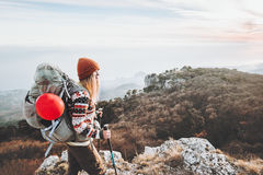 Woman Traveler with backpack mountaineering. Travel Lifestyle success concept adventure active vacations outdoor hiking sport Royalty Free Stock Images