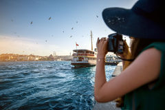 Woman traveler on the Bosphorus in Istanbul. Young woman traveler in green dress and hat enjoying great view of the Bosphorus in Istanbul stock images