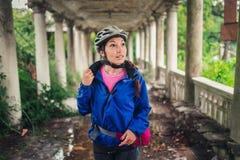 Woman traveler in building overgrown plants Stock Photo