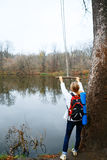 Woman traveler with bungee in the hands near autumn river Stock Photos