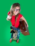 Woman traveler with a camera Stock Photography