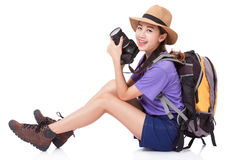 Woman traveler with a camera. On white background Stock Photo